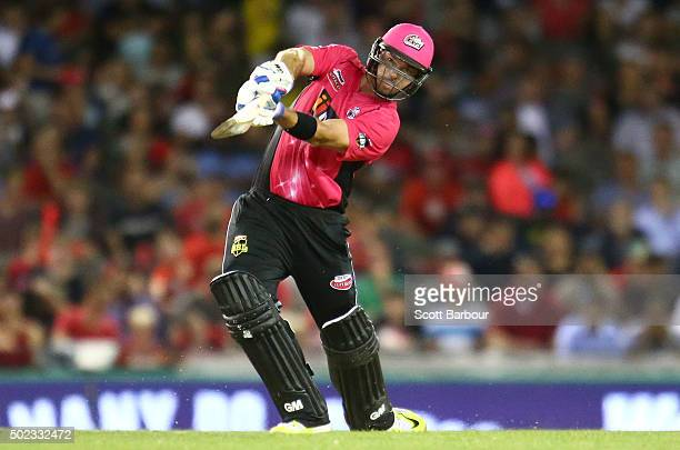 Michael Lumb of the Sixers hits a six during the Big Bash League match between the Melbourne Renegades and the Sydney Sixers at Etihad Stadium on...