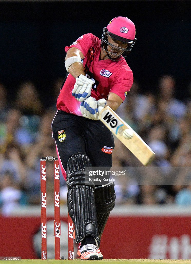 <a gi-track='captionPersonalityLinkClicked' href=/galleries/search?phrase=Michael+Lumb+-+Cricketer&family=editorial&specificpeople=6946049 ng-click='$event.stopPropagation()'>Michael Lumb</a> of the Sixers hits the ball to the boundary during the Big Bash League match between the Brisbane Heat and Sydney Sixers at The Gabba on January 11, 2015 in Brisbane, Australia.