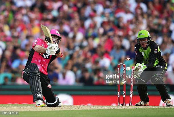Michael Lumb of the Sixers is bowled by Chris Green of the Thunder during the Big Bash League match between the Sydney Sixers and the Sydney Thunder...
