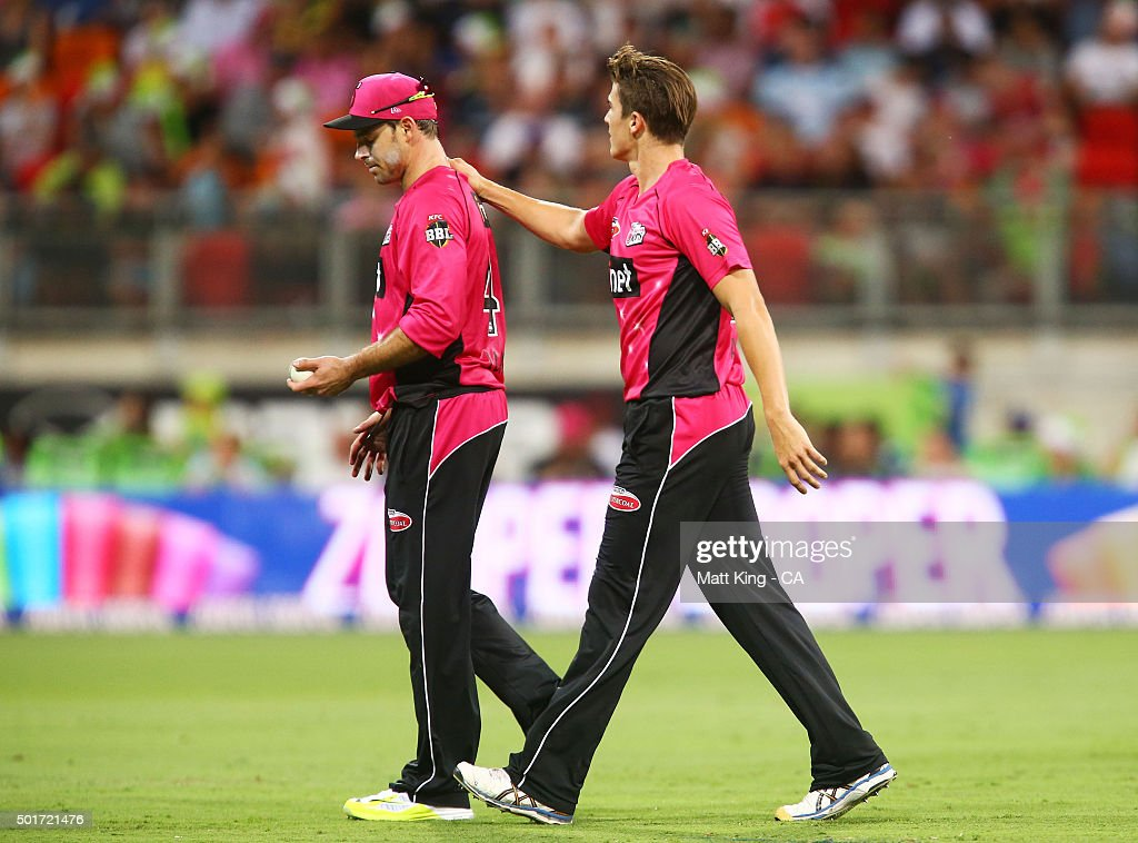 <a gi-track='captionPersonalityLinkClicked' href=/galleries/search?phrase=Michael+Lumb+-+Cricketer&family=editorial&specificpeople=6946049 ng-click='$event.stopPropagation()'>Michael Lumb</a> of the Sixers (L) looks delected after dropping a catch off the bowling of <a gi-track='captionPersonalityLinkClicked' href=/galleries/search?phrase=Sean+Abbott&family=editorial&specificpeople=5800264 ng-click='$event.stopPropagation()'>Sean Abbott</a> of the Sixers (R) during the Big Bash League match between the Sydney Thunder and the Sydney Sixers at Spotless Stadium on December 17, 2015 in Sydney, Australia.