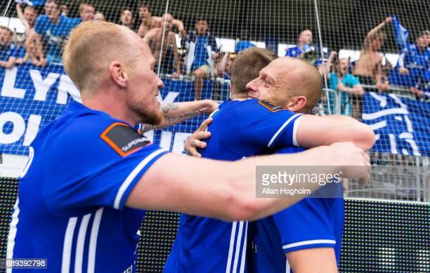 Michael Lumnb of Lyngby Boldklub and Mikkel Rygaard of Lyngby Boldklub celebrates their victory after the Danish Alka Superliga match between FC...