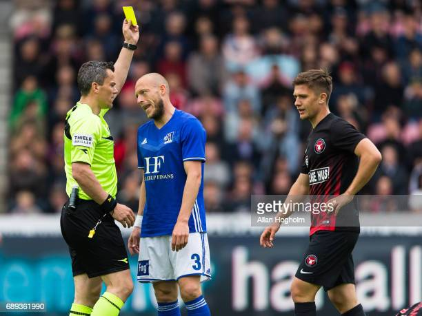 Michael Lumnb of Lyngby Boldklub receives a yellow card from Referee Michael Tykgaard the Danish Alka Superliga match between FC Midtjylland and...