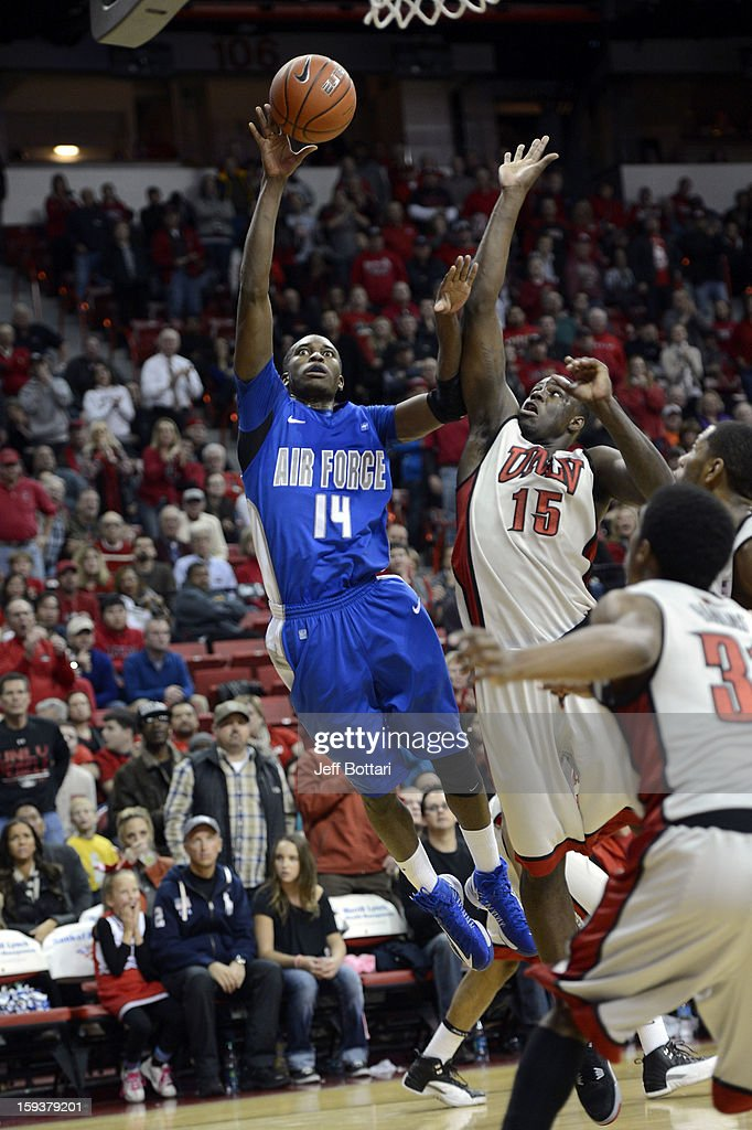 Michael Lyons #14 of the Air Force Falcons puts up a shot against Anthony Bennett #14 of the UNLV Rebels at the Thomas & Mack Center on January 12, 2013 in Las Vegas, Nevada. The Rebels won 76-71.