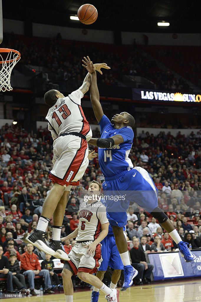 Michael Lyons #14 of the Air Force Falcons puts up a shot against <a gi-track='captionPersonalityLinkClicked' href=/galleries/search?phrase=Bryce+Dejean-Jones&family=editorial&specificpeople=10097417 ng-click='$event.stopPropagation()'>Bryce Dejean-Jones</a> #13 of the UNLV Rebels at the Thomas & Mack Center on January 12, 2013 in Las Vegas, Nevada. The Rebels won 76-71.