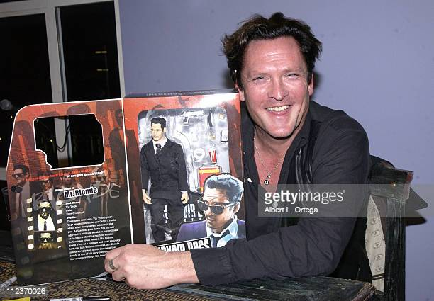 Michael Madsen poses with his action figure Mr Blond from 'Reservoir Dogs'