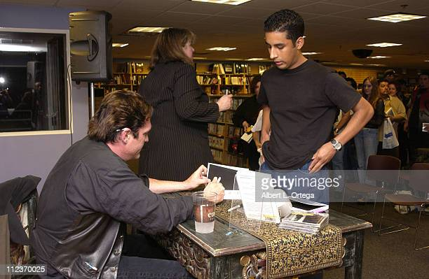 Michael Madsen signs autographs for fans during Actor Michael Madsen signs and reads from his poetry book 'A Blessing Of The Hounds' at Border's...