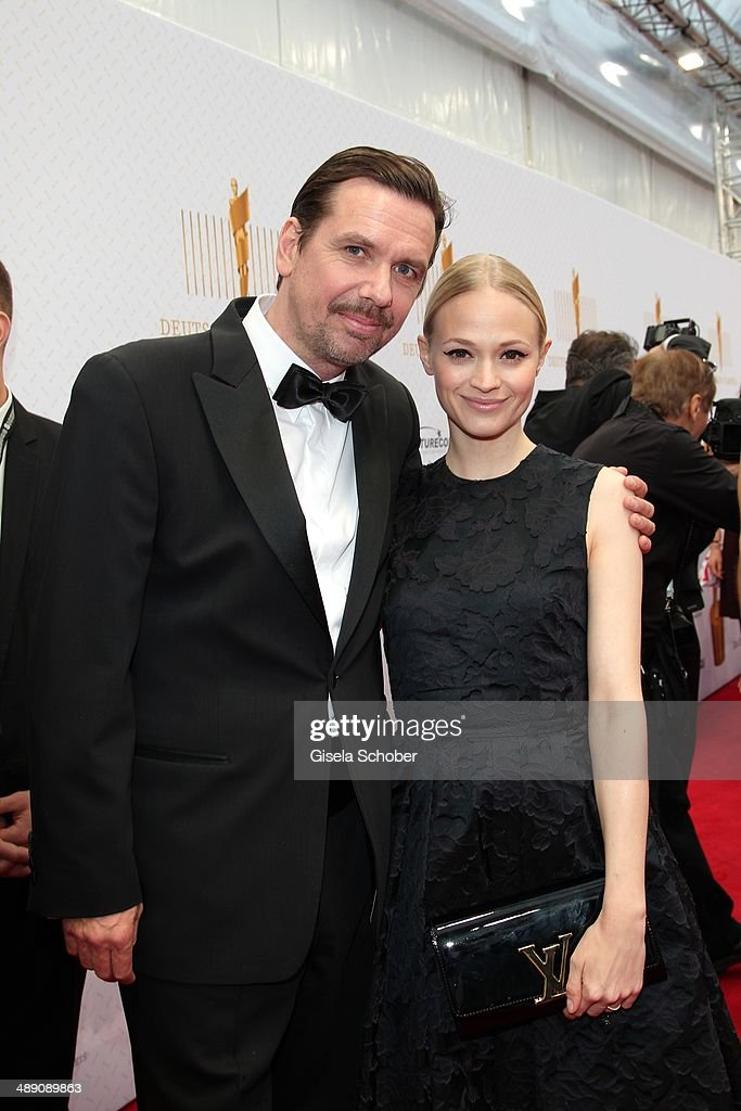 Michael Maertens and his wife Mavie Hoerbiger attend the Lola - German Film Award 2014 at Tempodrom on May 9, 2014 in Berlin, Germany.