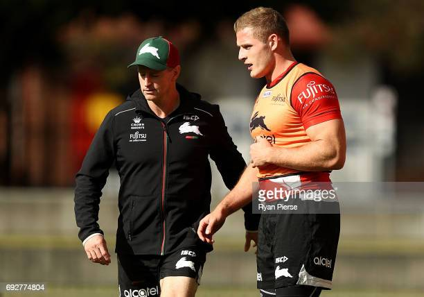 Michael Maguire coach of the Rabbitohs speaks to George Burgess of the Rabbitohs during the South Sydney Rabbitohs NRL training session at Redfern...