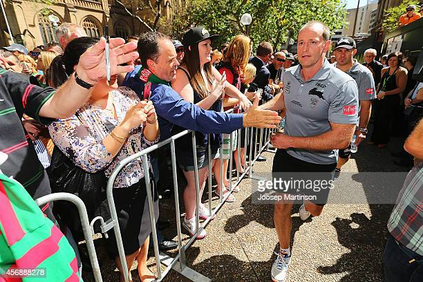 Michael Maguire walks on during a South Sydney Rabbitohs NRL Grand Final celebration at Sydney Town Hall on October 9 2014 in Sydney Australia