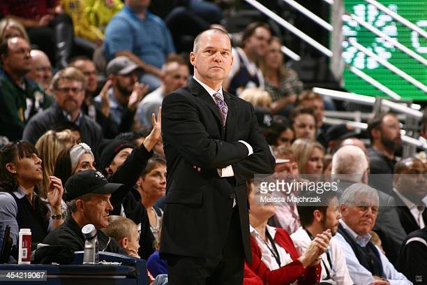 Michael Malone Head Coach of the Sacramento Kings watches his team play the Utah Jazz at EnergySolutions Arena on December 07 2013 in Salt Lake City...