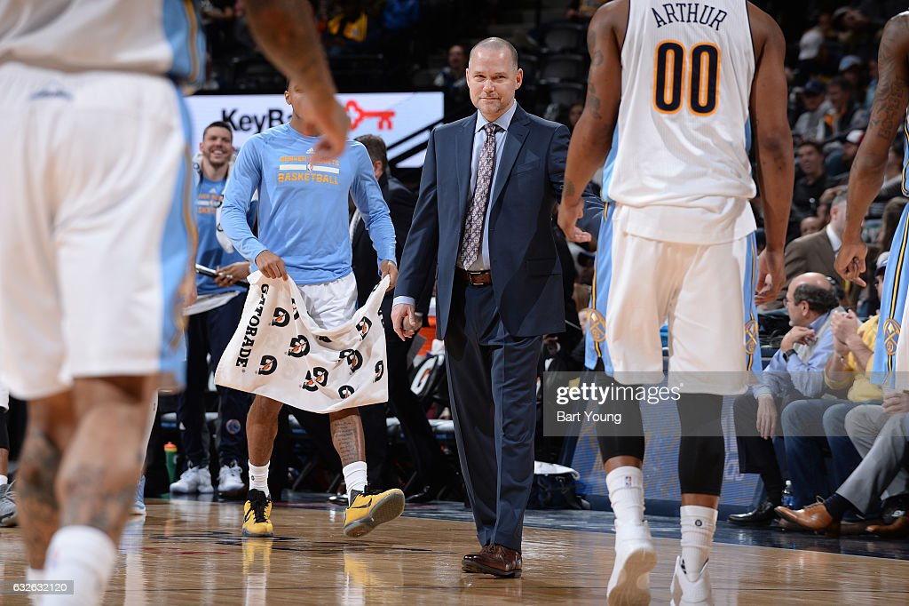 Michael Malone of the Denver Nuggets smiles during the game against the Utah Jazz on January 24, 2017 at the Pepsi Center in Denver, Colorado.