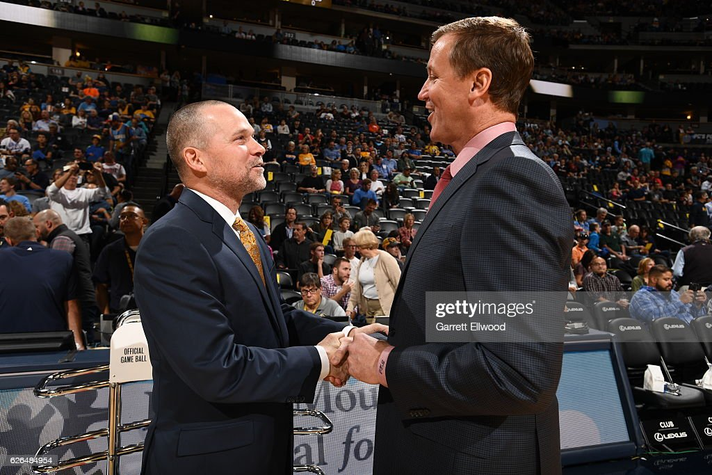 Michael Malone of the Denver Nuggets talks with Terry Stotts of the Portland Trail Blazers before a game on October 29, 2016 at the Pepsi Center in Denver, Colorado.
