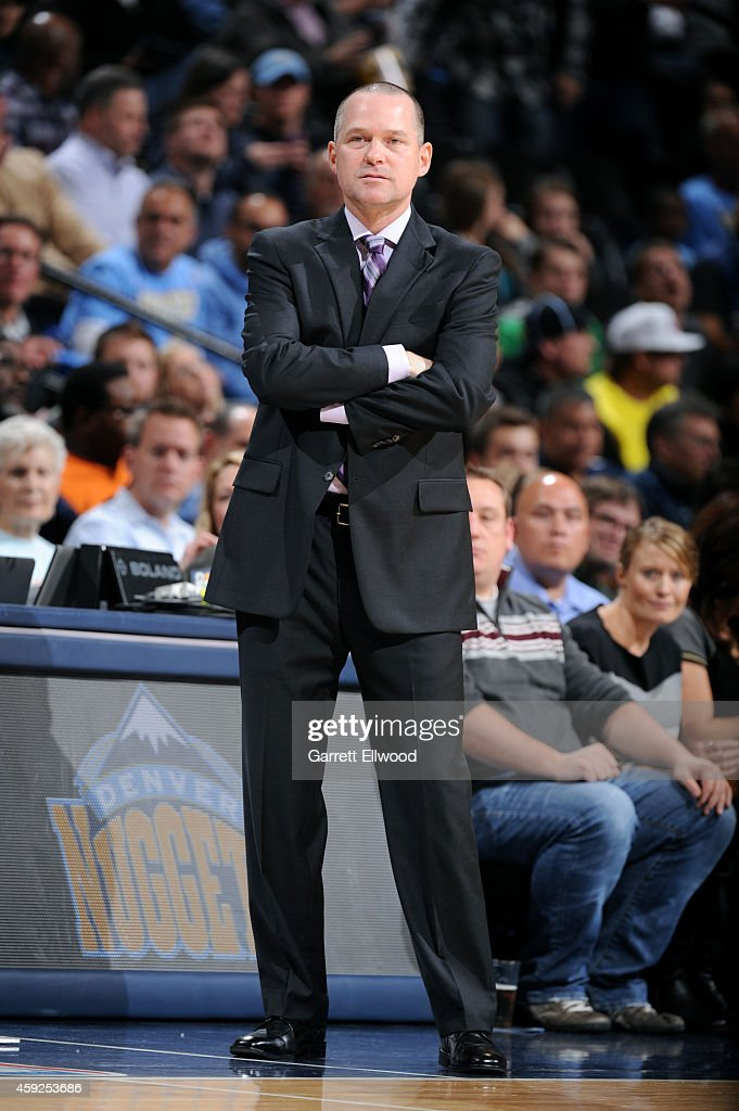 Michael Malone of the Sacramento Kings stands on the court during a game against the Denver Nuggets on November 3, 2014 at the Pepsi Center in Denver, Colorado.