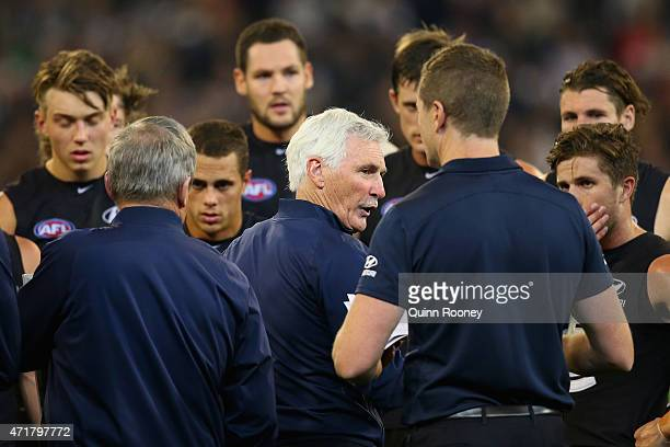 Michael Malthouse the coach of the Blues talks to his players during the round five AFL match between the Carlton Blues and the Collingwood Magpies...