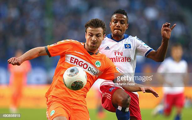 Michael Mancienne of Hamburg and Ilir Azemi of Fuerth battle for the ball during the 1 Bundesliga Playoff First Leg match between between Hamburger...
