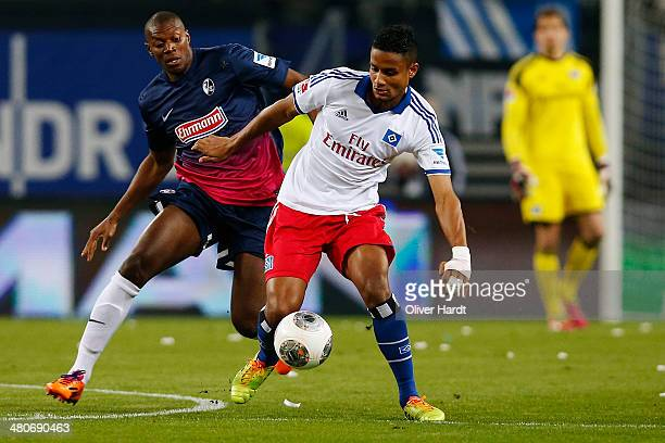 Michael Mancienne of Hamburg and Karim Guede of Freiburg compete for the ball during the Bundesliga match between Hamburger SV and SC Freiburg at...