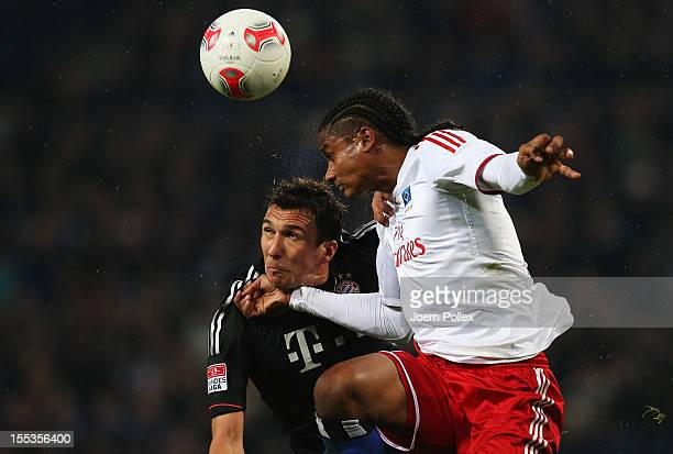 Michael Mancienne of Hamburg and Mario Mandzukic of Muenchen compete for the ball during the Bundesliga match between Hamburger SV and FC Bayern...