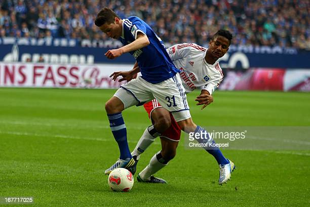 Michael Mancienne of Hamburg challenges Julian Draxler of Schalke during the Bundesliga match between FC Schalke 04 and Hamburger SV at VeltinsArena...
