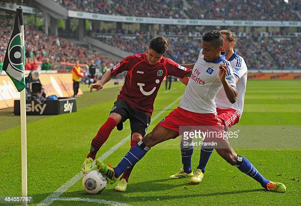 Michael Mancienne of Hamburg is challenged by Leonardo Bittencourt of Hannover during the Bundesliga match between Hannover 96 and Hamburger SV at...