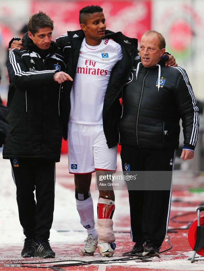 Michael Mancienne of Hamburg is led off the pitch during the Bundesliga match between 1. FC Nuernberg and Hamburger SV at Easy Credit Stadium on January 20, 2013 in Nuremberg, Germany.