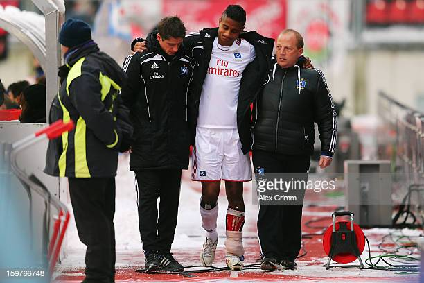 Michael Mancienne of Hamburg is led off the pitch during the Bundesliga match between 1 FC Nuernberg and Hamburger SV at Easy Credit Stadium on...