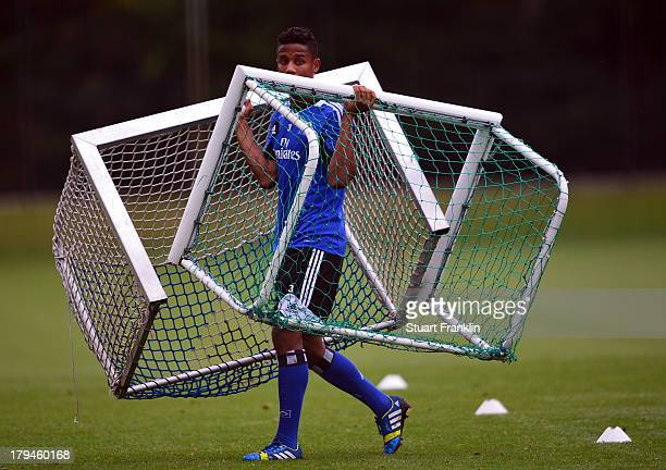 Michael Mancienne of Hamburg moves the goal posts during a training session of Hamburger SV on September 4 2013 in Hamburg Germany