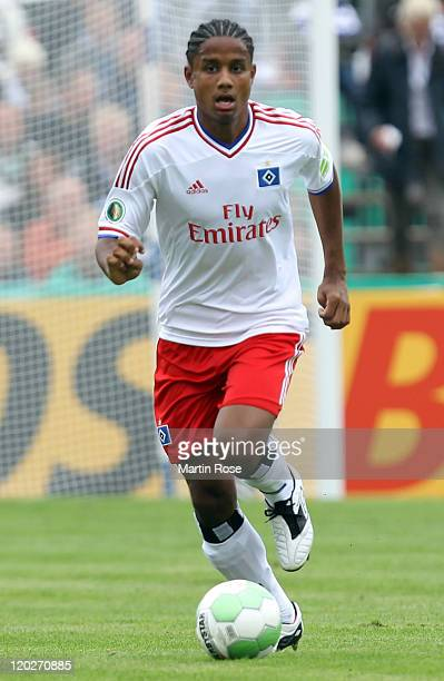 Michael Mancienne of Hamburg runs with the ball during the DFB Cup first round match between VfB Oldenburg and Hamburger SV at Marschweg stadium on...