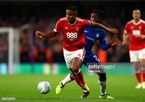 Michael Mancienne of Nottingham Forest and Michy Batshuayi of Chelsea battle for possession during the Carabao Cup Third Round match between Chelsea...