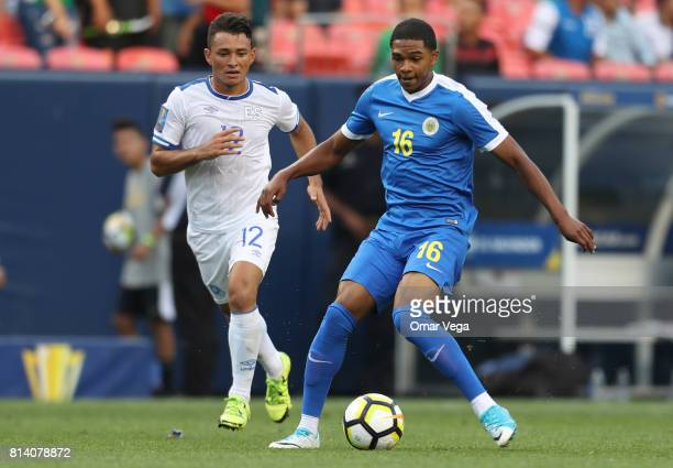Michael Maria of Curacao plays the ball followed by Narciso Orellana of El Salvador during the CONCACAF Gold Cup Group C match between El Salvador...