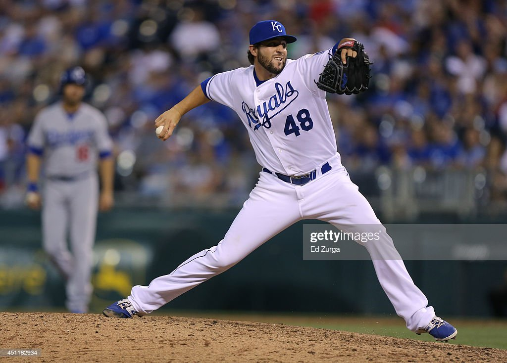 Michael Mariot #48 of the Kansas City Royals throws against the Los Angeles Dodgers in the ninth inning at Kauffman Stadium on June 24, 2014 in Kansas City, Missouri.