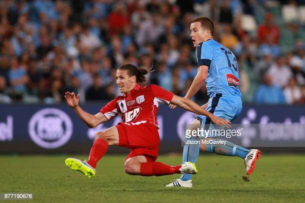 Michael Marrone of Adelaide and Brandon O'Neill of Sydney during the FFA Cup Final match between Sydney FC and Adelaide United at Allianz Stadium on...