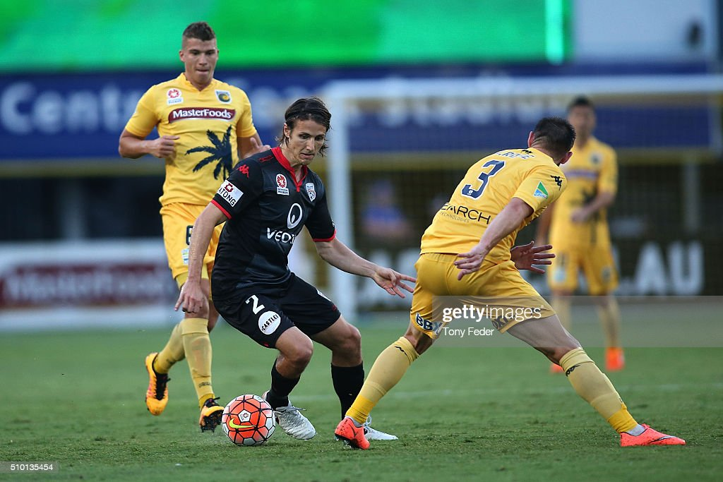 Michael Marrone of Adelaide contests the ball with Joshua Rose of the Mariners during the round 19 A-League match between the Central Coast Mariners and Adelaide United at Central Coast Stadium on February 14, 2016 in Gosford, Australia.