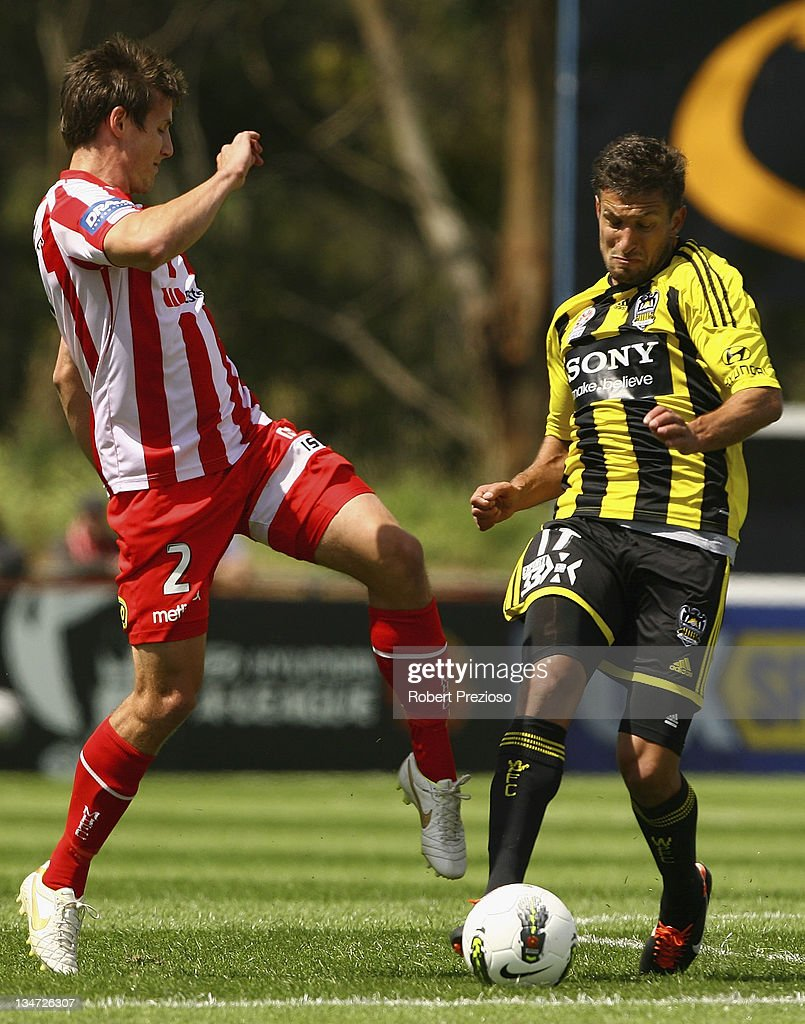 Michael Marrone of the Heart and Vince Lia of the Phoenix contest the ball during the round nine A-League match between the Melbourne Heart and the Wellington Phoenix at Latrobe City Sports & Entertainment Complex on December 4, 2011 in Melbourne, Australia.