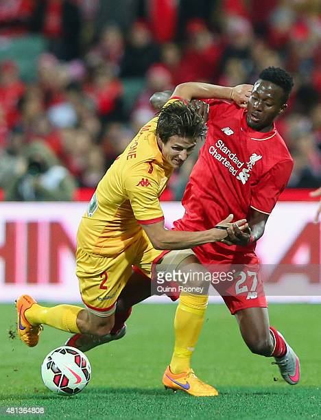 Michael Marrone of United and Divock Origi of Liverpool FC compete for the ball during the international friendly match between Adelaide United and...