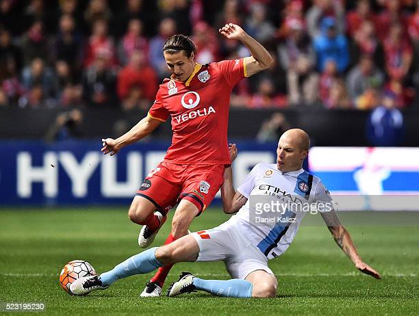 Michael Marrone of United is tackled by Aaron Mooy of Melbourne City during the ALeague Semi Final match between Adelaide United and Melbourne City...