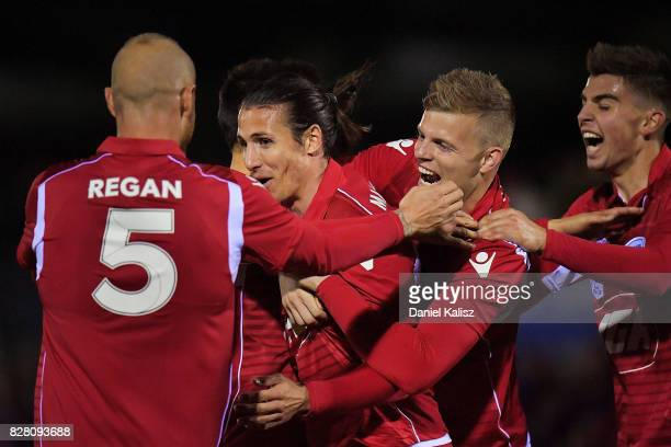 Michael Marrone of Unitred celebrates with his team mates after scoring a goal during the round of 32 FFA Cup match between Adelaide United and the...