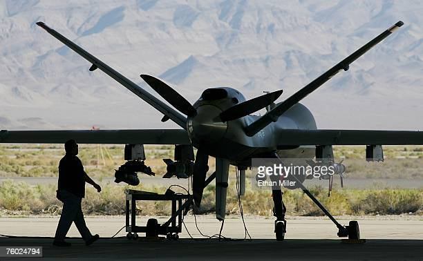 Michael Martinez airframe and power plant mechanic with General Atomics Aeronautical Systems Inc inspects an MQ9 Reaper during a preflight check...