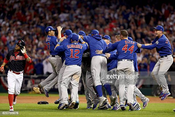 Michael Martinez of the Cleveland Indians reacts as the Chicago Cubs celebrate after defeating the Indians 87 in Game Seven of the 2016 World Series...