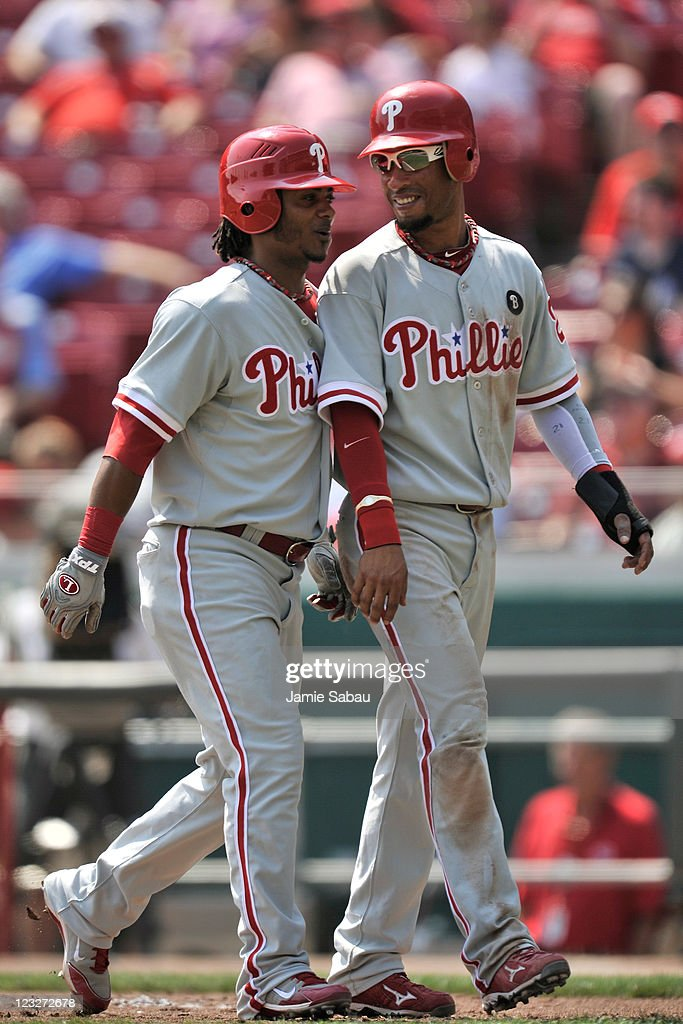 Michael Martinez #19 of the Philadelphia Phillies and Wilson Valdez #21 of the Philadelphia Phillies celebrate Martinez's two-run home run against the Cincinnati Reds at Great American Ball Park on September 1, 2011 in Cincinnati, Ohio. Philadelphia completed the series sweep with a 6-4 win over Cincinnati.