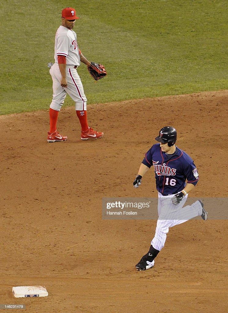 Michael Martinez #7 of the Philadelphia Phillies looks on as <a gi-track='captionPersonalityLinkClicked' href=/galleries/search?phrase=Josh+Willingham&family=editorial&specificpeople=537640 ng-click='$event.stopPropagation()'>Josh Willingham</a> #16 of the Minnesota Twins rounds the bases after hitting a solo home run during the sixth inning on June 12, 2012 at Target Field in Minneapolis, Minnesota.