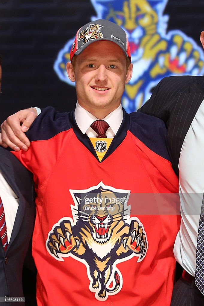 Michael Matheson, 23rd overall pick by the Florida Panthers, poses on stage during Round One of the 2012 NHL Entry Draft at Consol Energy Center on June 22, 2012 in Pittsburgh, Pennsylvania.