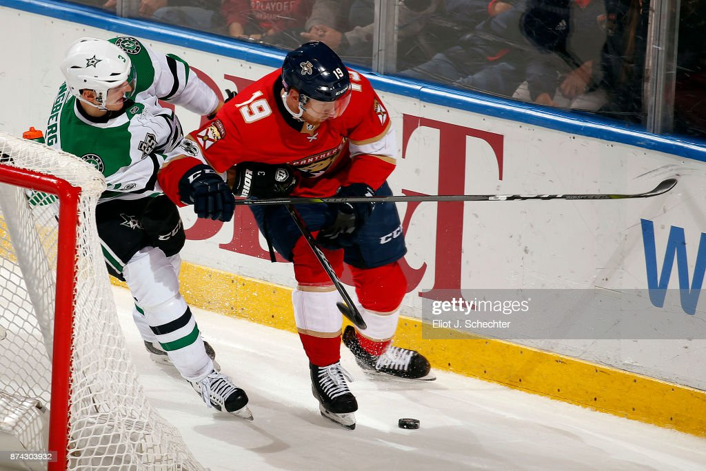 Michael Matheson #19 of the Florida Panthers digs the puck out from the boards against John Klingberg #3 of the Dallas Stars in overtime at the BB&T Center on November 14, 2017 in Sunrise, Florida.