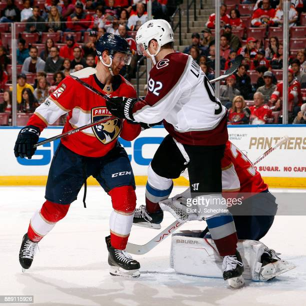 Michael Matheson of the Florida Panthers tangles with Gabriel Landeskog of the Colorado Avalanche at the BBT Center on December 9 2017 in Sunrise...