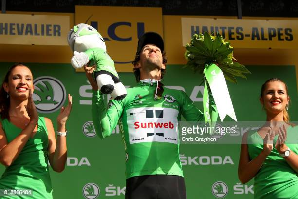 Michael Matthews of Australia riding for Team Sunweb celebrates on the podium after taking the green points jersey during stage 17 of the 2017 Le...