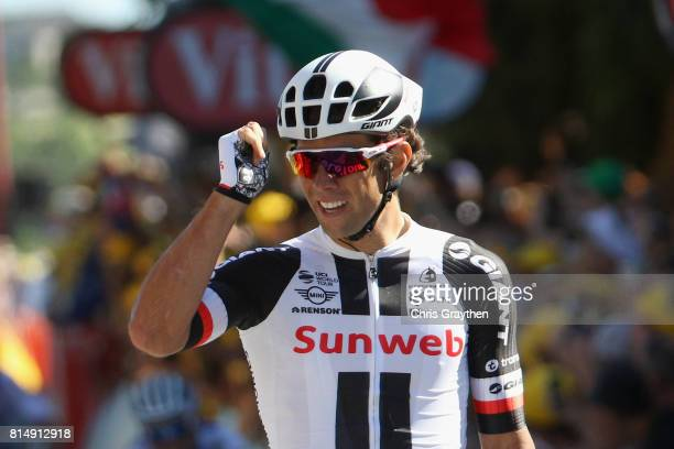 Michael Matthews of Australia riding for Team Sunweb celebrates crossing the finish line and winning the stage during stage 14 of the Le Tour de...