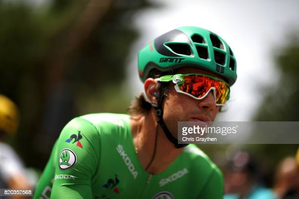 Michael Matthews of Australia riding for Team Sunweb in the green points jersey rides to the start of stage 19 of the 2017 Le Tour de France a 2225km...