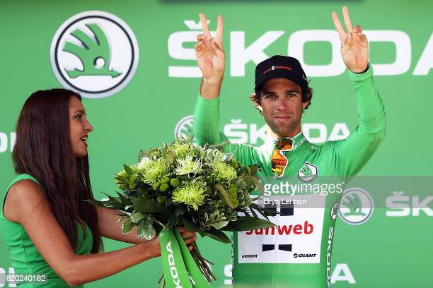 Michael Matthews of Australia riding for Team Sunweb is presented with the green sprinters jersey on the podium after stage nineteen of the 2017 Tour...