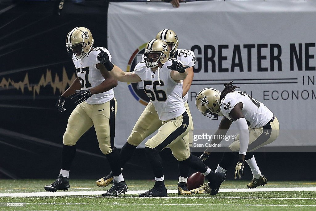 Michael Mauti #56 of the New Orleans Saints reacts to a touchdown folllowing a blocked punt during the first quarter of a game against the Atlanta Falcons at the Mercedes-Benz Superdome on October 15, 2015 in New Orleans, Louisiana.