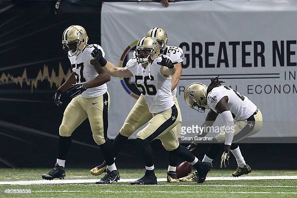 Michael Mauti of the New Orleans Saints reacts to a touchdown folllowing a blocked punt during the first quarter of a game against the Atlanta...