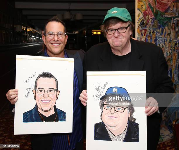Michael Mayer and Michael Moore during the Michael Moore And Michael Mayer portrait unveilings as they join the Wall of Fame at Sardi's on September...